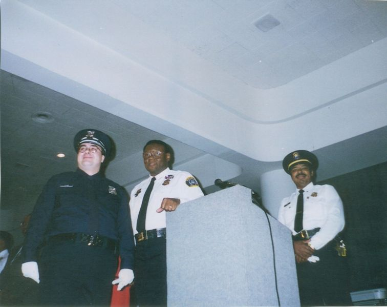 Officer Sean Lane with Detroit Chief of Police Isaiah McKinnon
